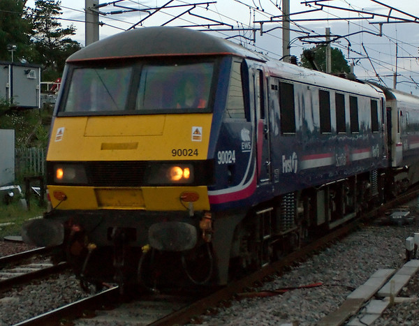 90024, 1S26, Carnforth, 3 July 2008 - 0503    First ScotRail's 2345 Euston - Glasgow and Edinburgh sleeper, running about one hour late following signalling problems between Crewe and Preston.