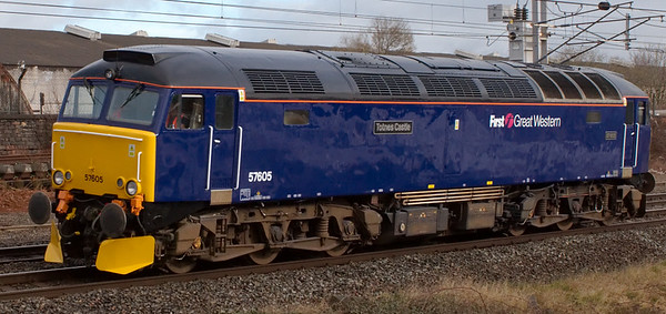 57605 Totnes Castle, 0Z57, Carnforth, 27 March 2008 - 0920   The FGW loco, which normally leads a nocturnal life on Paddington - Penzance sleepers, makes a very rare appearance on the WCML returning to Old Oak Common after a repaint from green to blue at Brush Kilmarnock.