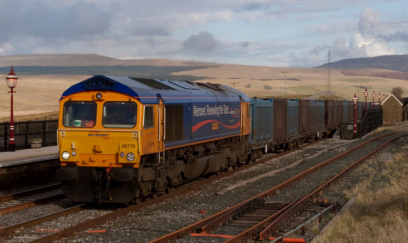 66719 Metro-Land, 4M91, Ribblehead, 9 April 2008 - 1744 1  GBRf's Metronet-liveried loco passes the catchpoints at the entrance to Ribblehead Quarry with gypsum to Kirkby Thore from West Burton or Cottam Power Station.
