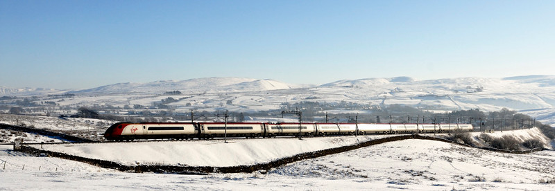 390051 Virgin Ambassador, Greenholme, Fri 8 January 2010 - 1228     The Pendo sweeps up snow-covered Shap on a glorious winter's day