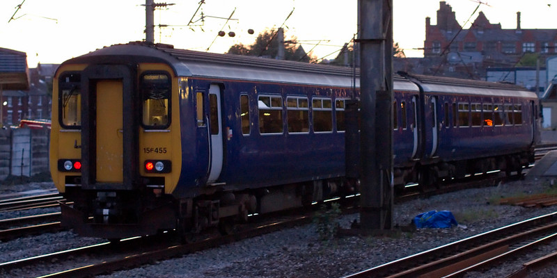 156455, Preston, 24 July 2009 - 2123    One of the last two 156s still wearing plain indigo arrives at platform 1 with Northern's 2025 Liverpool - Blackpool North.