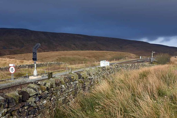 Signals, Blea Moor, Wed 15 February 2017.   New signal BM 29 at left was installed in autumn 2015 to allow stone trains from Arcow quarry to enter the loop in order to reverse.  Barely visible in front of the semaphore is a new CCTV camera installed at the same time so that the Blea Moor signaller can confirm that a down train in the loop is complete and has its tail lamp.  There has been a similar camera at the northern end of the loop for up trains for several years.