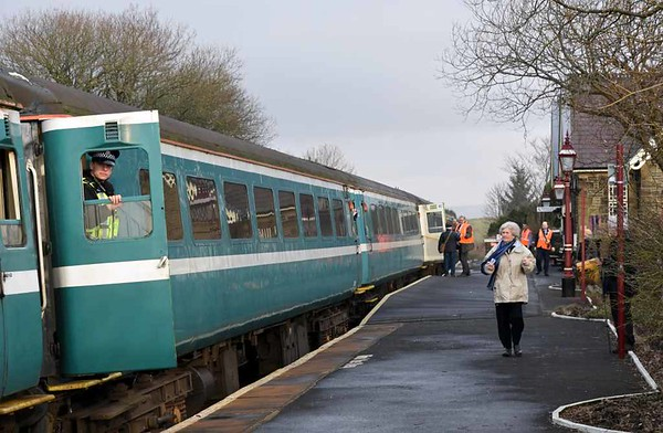 60163 Tornado & 67029 Royal Diamond, 2Z22, Horton-in-Ribblesdale, Wed 15 February 2017 2.  Three or four passengers joined the train.  The nine coaches were former Anglia Mark 2s 6042, 5964, 5929, 9520, 5985, 5998, 5950 & 5921 and Tornado support coach 21249. Four coaches were reserved for advance bookings, and four were available on the day. As the presence of the British Transport Police officer shows, there had been concerns that the plandampf might see a repeat of the mass trespass generated by Flying Scotsman in 2016 when it returned to the main line.  In the event there was huge interest in the trains, spurred by extensive TV coverage, but there were no problems.  Note the 'Harrington hump' installed to heighten part of this low platform.