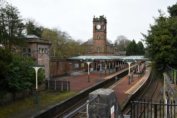 Ulverston station, 14 March 2017 3.  Looking from the 1854 terminus.  The gate in the right foreground leads to a stairway by which passengers reached their trains after buying their tickets in the 1854 terminus until this station opened.