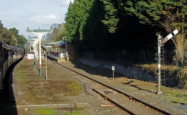 Ulverston station 6: 12 April 2014.  Approaching the station on an eastbound Cumbrian Coast Express hauled by 46115 Scots Guardsman.