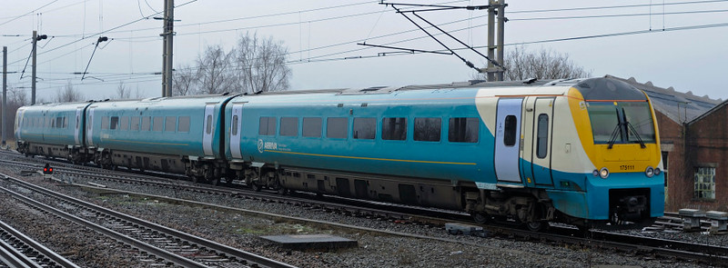 175111, Warrington Bank Quay, Thurs 4 February 2010 - 1016    Arriva Trains Wales's 0845 Llandudno - Manchester Piccadilly approaches platform 4.