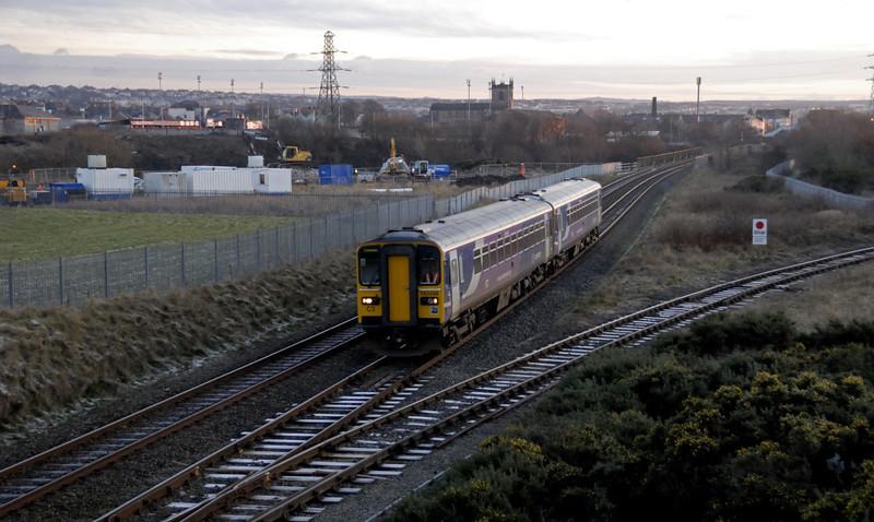 153328 & 153331, Workington, 18 December 2009 - 1533 1.    Northern's 1331 Barrow - Carlisle passes Derwent Junction....