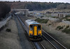 153328 & 153331, Workington, 18 December 2009 - 1533 2.    ...and approaches the temporary station.