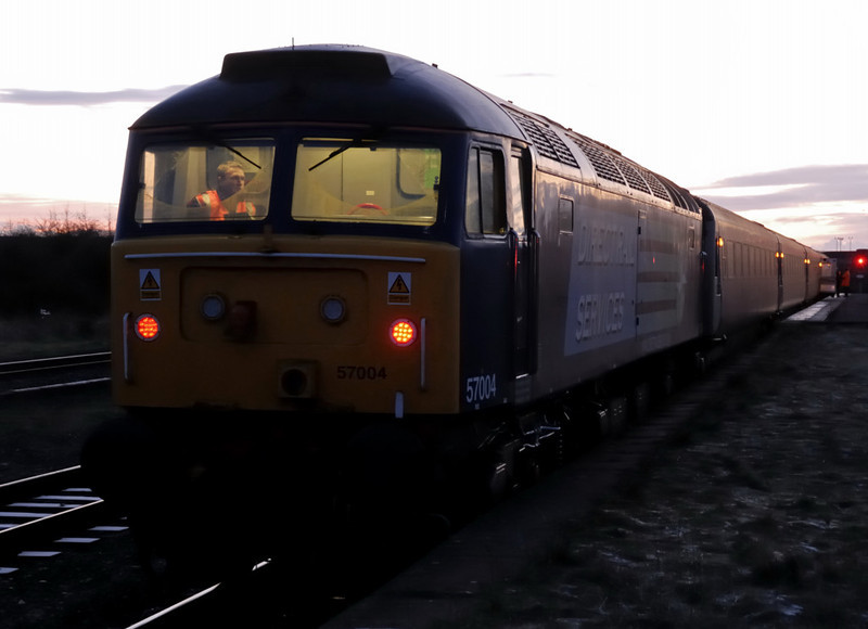 57004, Maryport, 18 December 2009 1 - 1612.    The 57's driver takes a break after working DRS's 1550 shuttle from Workington.