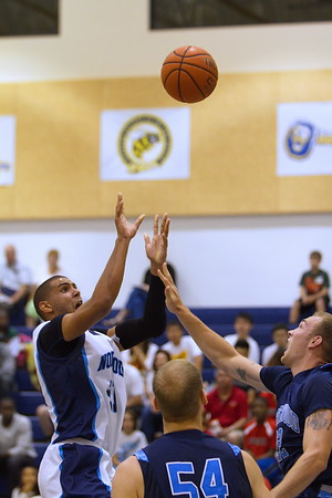 Masse Doumbe shoots over Timberwolves defenders