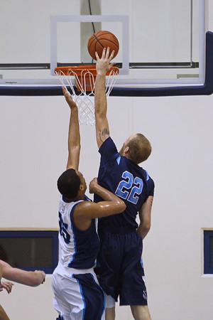 Timberwolves' Will Bowles (22) gets a tip in