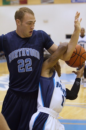 Will Bowles (22) and Ty Davis fight for loose ball