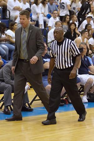 Timberwolves coach Jeff Rekeweg converses with a referee