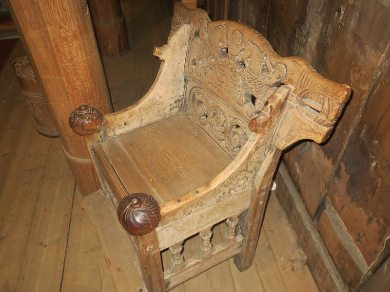 """The """"bishop's chair"""" possibly predating Christianity in Norway. If you look at the carving, there's no cross on this chair. So was it made in the Viking era?..It now sits in the Heddal stave church Norway."""