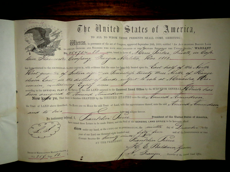 This is an interesting document. It's a deed for land.. so-called government land. The land was given to veterans of the war of 1812... when you think about it, they were too old to farm it, so they sold it to new immigrants who are young enough to clear the land and carve out a life. It's dated December ninth 1854.
