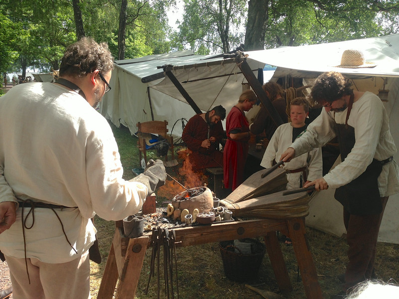 A Viking encampment. Wind holders need blast. Iron forging was central to life.