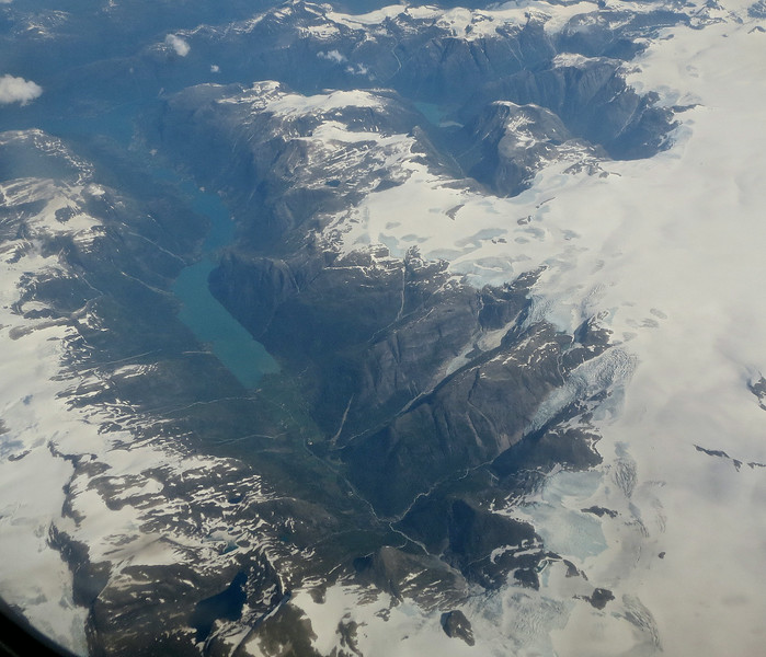 As I flew out of Norway on July 10th 2014, I took this photograph of Jostedalsbreen National Park. The valley is surrounded by glacier. I hiked with Kaia here two years ago, just a little below the central part of this photo.
