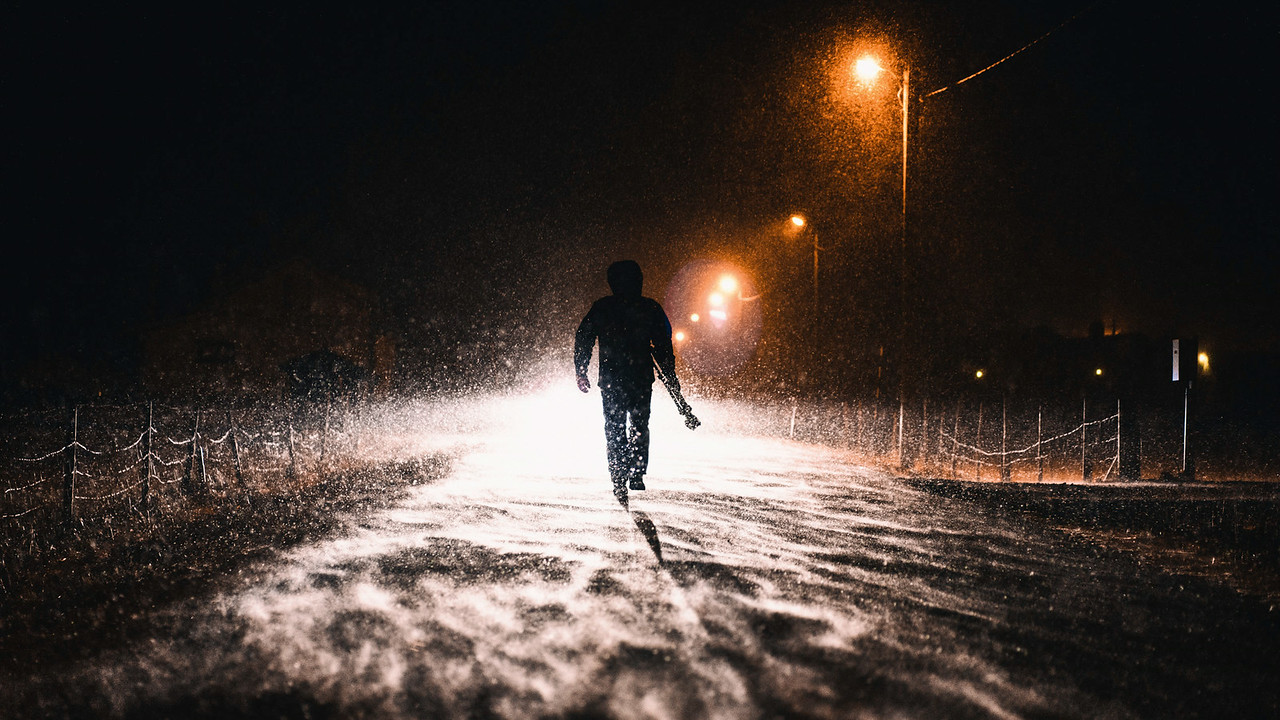 On our first night in camp, the blizzard hit fast and furious. Always looking for a dramatic photograph, Chris walks in search of another night shot in the blistering snow.