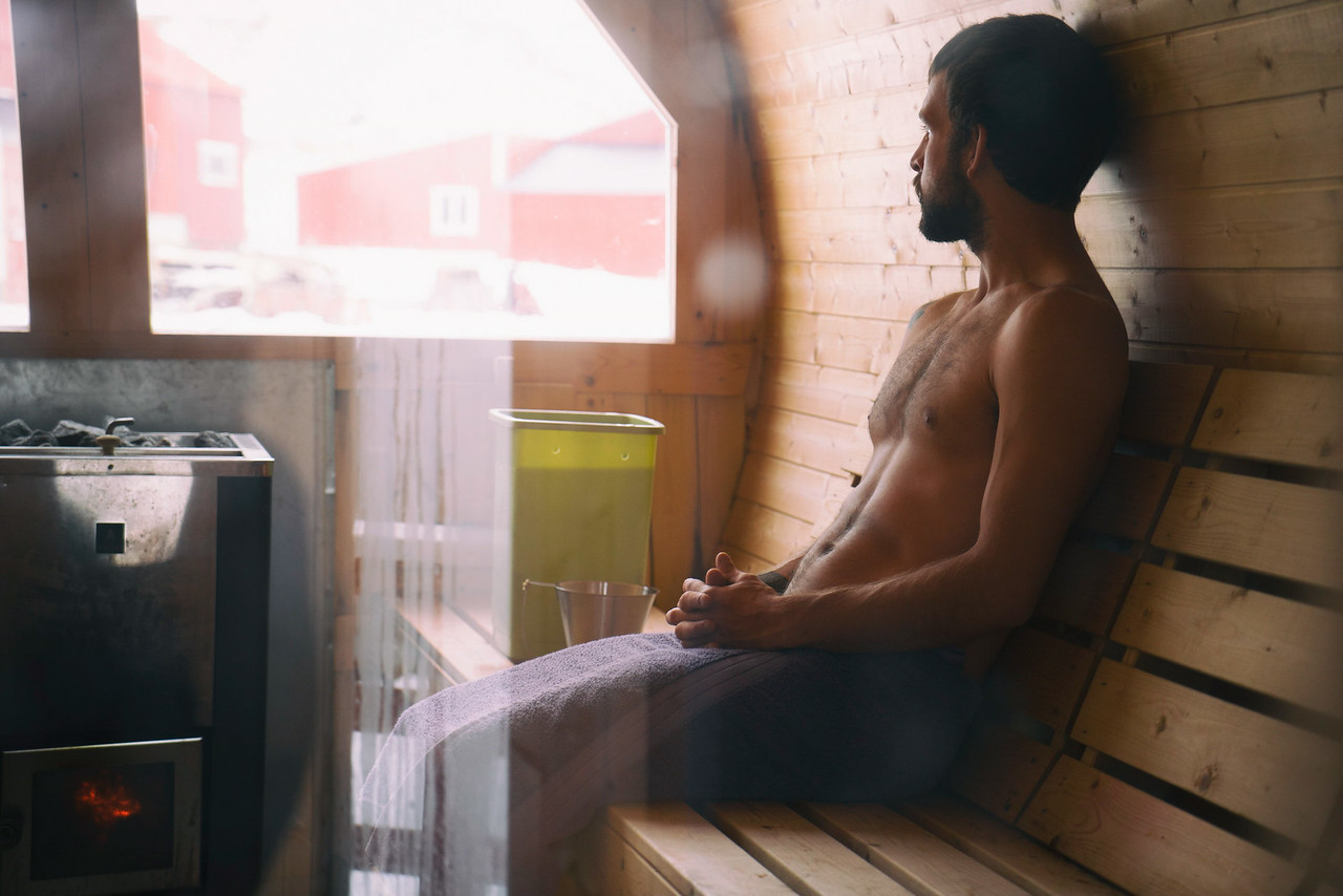 Chadd enjoys the sauna while taking in the quiet surroundings.