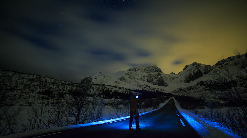 Chris' love for night Photography and empty roads intersect in the dark Arctic Night