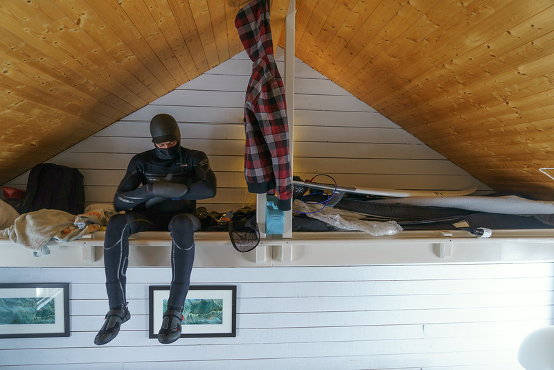 Brett puts on his wetsuit and prepares to jump into his first session in the Arctic.