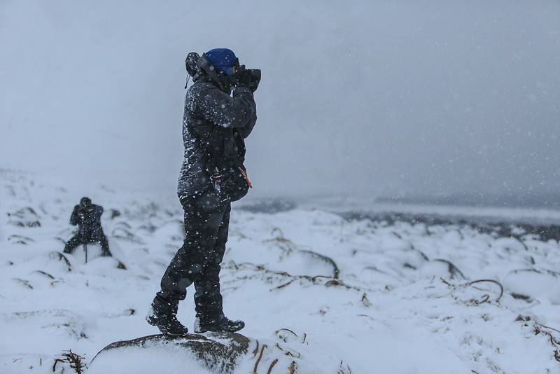Standing on shore, Chris captures a cold arctic morning surf session as Anton films from afar.