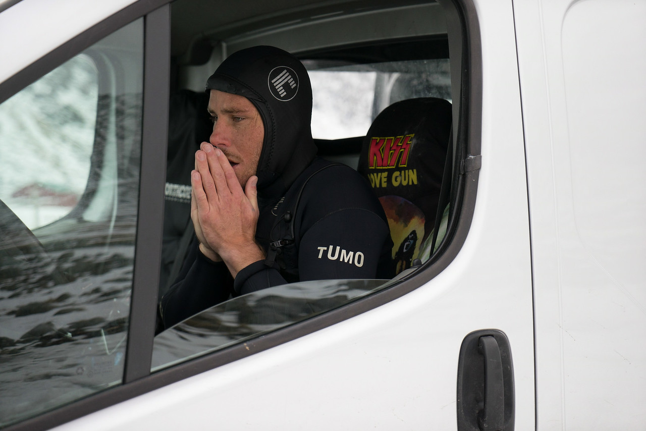 Pat warms up his hands in his KISS van after a morning session in the frigid Arctic Waters