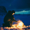 After a long, cold day, Chris starts a fire in camp. The campfire is a gathering place for the surfers to huddle and trade stories about the days rides.