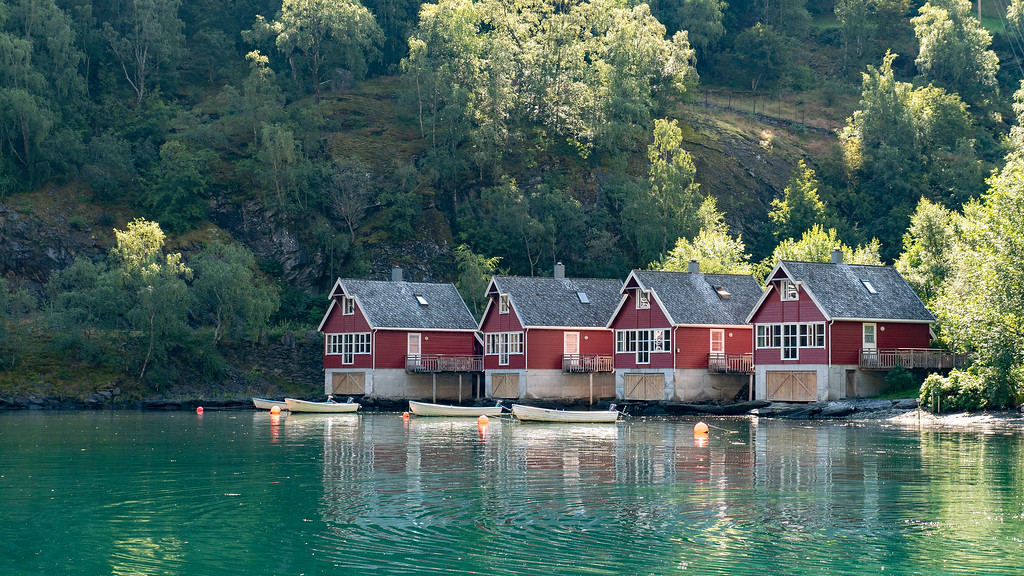 Little red cabins on the water in Flam Norway