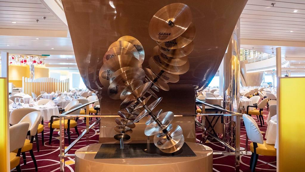Nieuw Statendam art - cymbal artwork in dining room