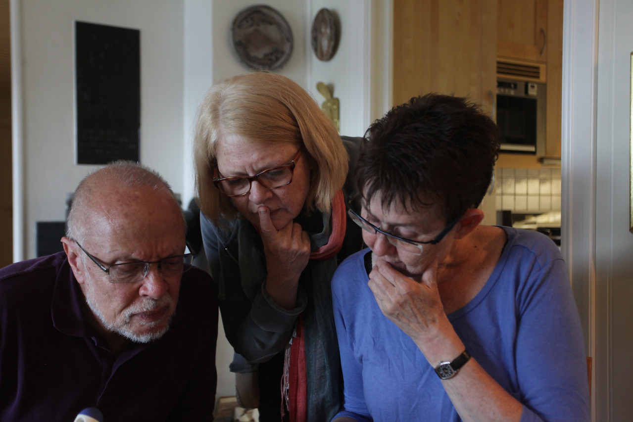 Looking at family photos and geneology records, at Tove's  home in nearby Treungen.