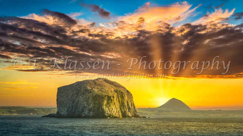 A bird rock in the North Atlantic Ocean at sunset.