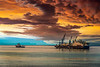 The ship Castarone, an oil pipe laying vessel in the North Atlantic with dramatic clouds and sunset.