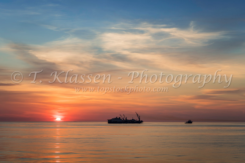 The ship Castarone, an oil pipe laying vessel in the North Atlantic at sunset.