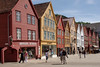 Velkommen til Bergen!    The distinctive wooden buildings on the Bryggen quay are a Bergen trademark.  They are 18th and 19th century replacements for earlier buildings which burnt down..  Originally warehouses for Bergen's extensive maritime trade, they are now smart resturants and shops, like similar waterfront buildings around the world.