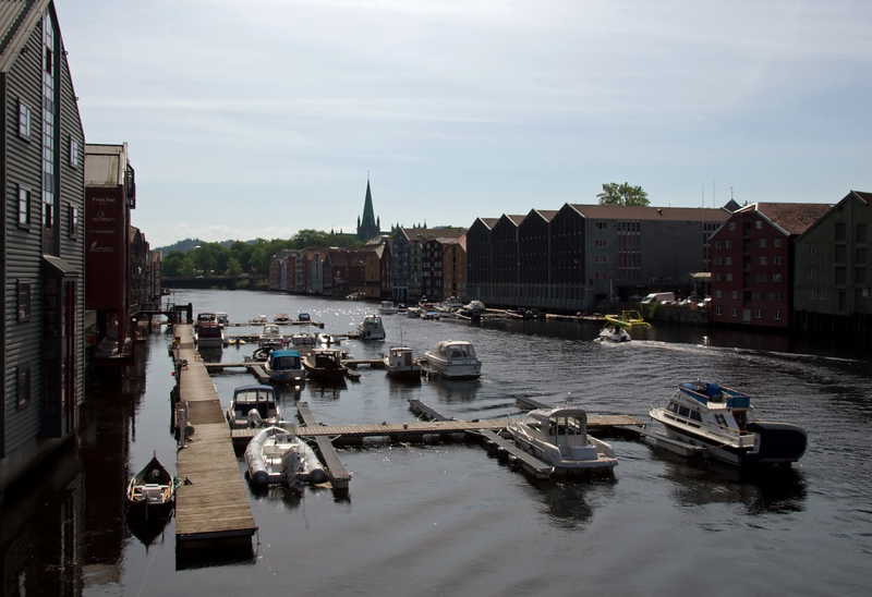 River Nid warehouses, Trondheim, 5 June 2008 4    A last look, with the old town bridge and the spire of Nidaros Cathedral again visible.