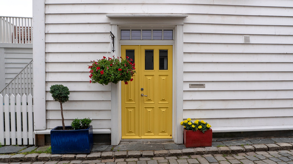 Yellow door and white house in Old Stavanger Norway