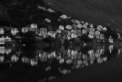 The town of Odda reflected in the fjord