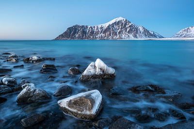 Frozen rocks on Skagsanden beach in Lofoten Norway