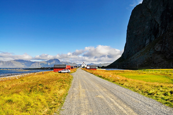 Village towered by a steep mountain on Lofoten