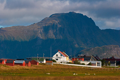 Village towered by a steep mountain in northern Norway