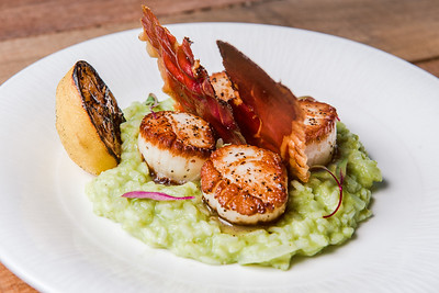 In this photo: SPECKLED SCALLOPS with asparagus risotto, crispy smoked prosciutto, brown butter, and charred lemon at Nosh restaurant, Rochester, NY. Photo by Brandon Vick, http://www.brandonvickphotography.com/