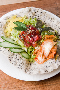 In this photo: DEL MAR AHI POKE with tuna, cucumber, shaved lettuce, daikon, nori, sesame rice cracker, and lemongrass vinaigrette at Nosh restaurant, Rochester, NY. Photo by Brandon Vick, http://www.brandonvickphotography.com/