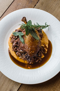 In this photo: PATO CONFIT crescent farms duck with spiced sweet potato puree, red wine farro, top of the hill mushrooms, and fried herbs at Nosh restaurant, Rochester, NY. Photo by Brandon Vick, http://www.brandonvickphotography.com/