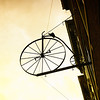 Hanging antique bicycle sign in Madison, Indiana.