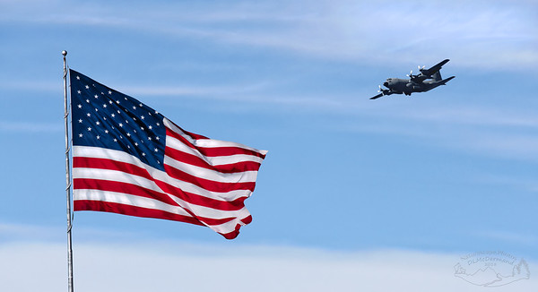 Old Glory Salutes a Military Cargo Plane