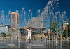 Kid in fountain at Baltimore's Inner Harbor<br /> <br /> Although I took this photograph last fall it looks like late spring.<br /> Enjoy your weekend!