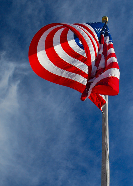 110310<br /> Swirling Winds of Change<br /> <br /> On Election Day yesterday in our uncertain world I took this picture looking up at the flag on Federal Hill overlooking the harbor in Baltimore.