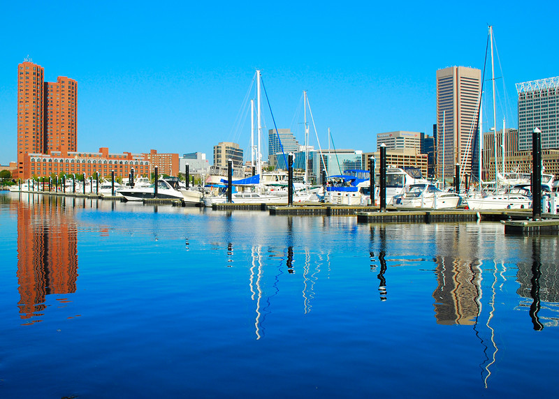 092110<br /> Baltimore and Inner Harbor Marina<br /> <br /> With a slow economy and the end of the summwr the boats at the edge of the marina have become sparse.