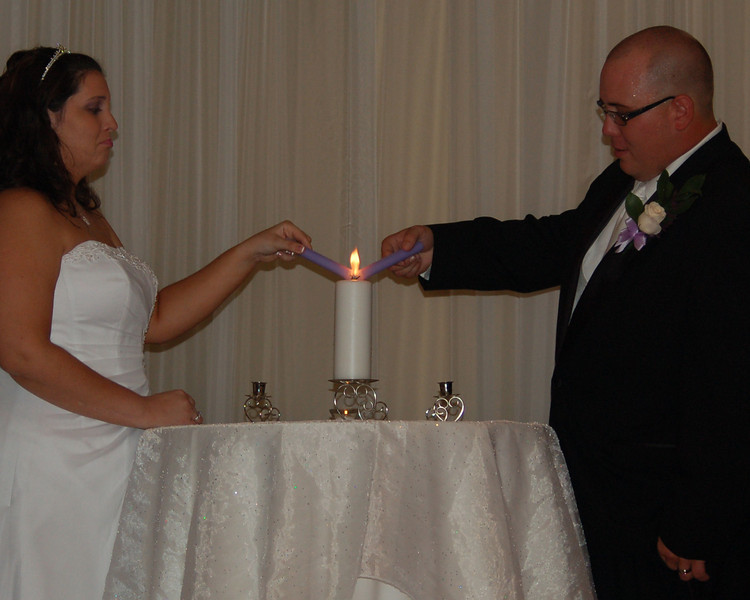 Kirby & Greg attempting to light the unity candle.